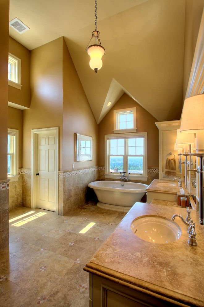 Sherwin Williams Softer Tan for a Traditional Bathroom with a Soaker Tub and Issaquah Highlands Residence by Hilary Young Design Associates
