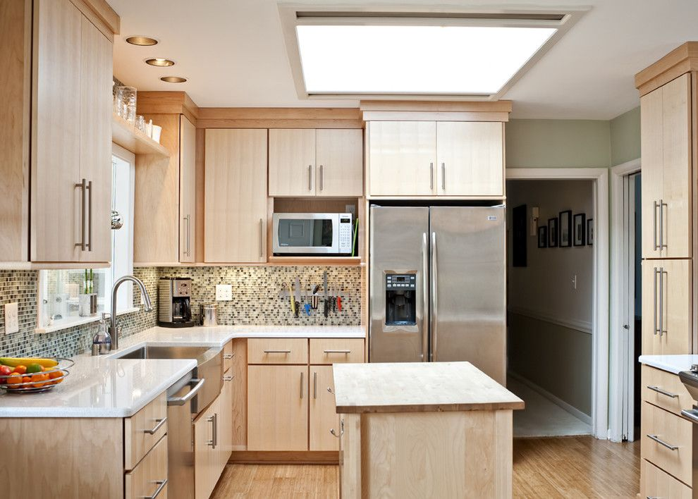 Shiloh Cabinets for a Contemporary Kitchen with a Bamboo Floor and Cool and Bright Kitchen by Rock Paper Hammer