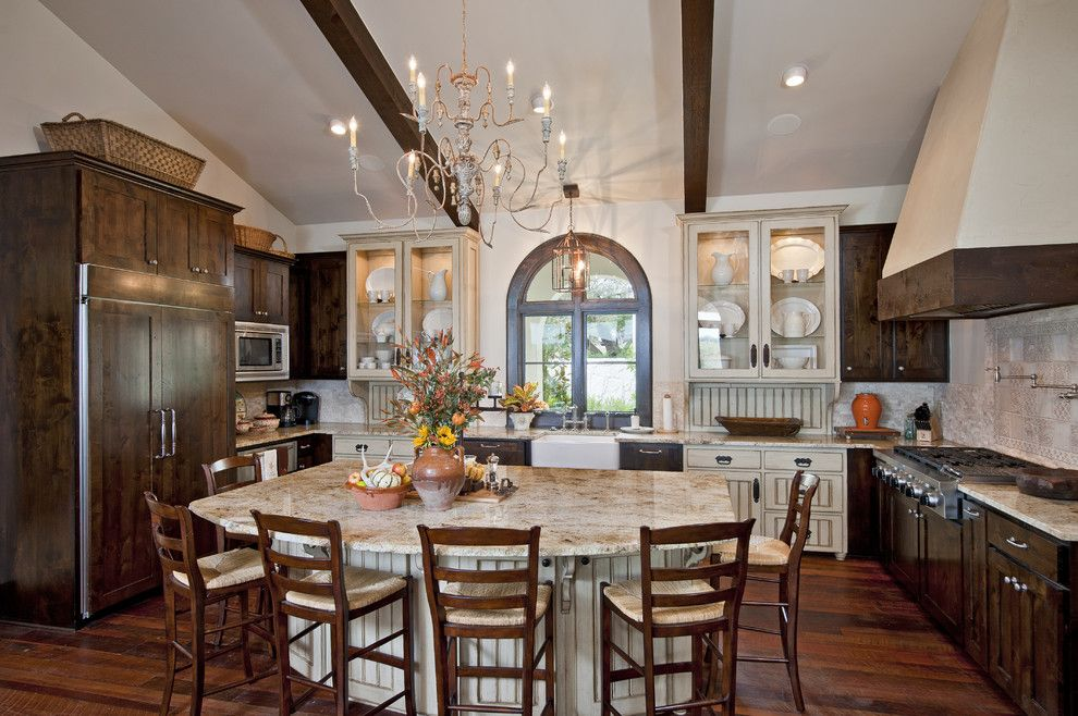 Shiloh Cabinets for a Mediterranean Kitchen with a Arched Window and Great Kitchens by Jenkins Custom Homes