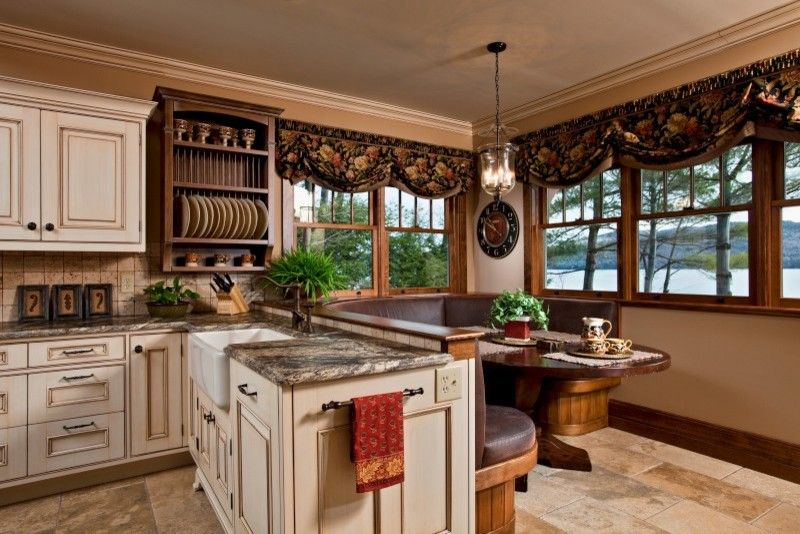 Shiloh Cabinets for a Traditional Kitchen with a Reclaimed Wood Trusses and Legend of the Lake by Teakwood Builders, Inc.