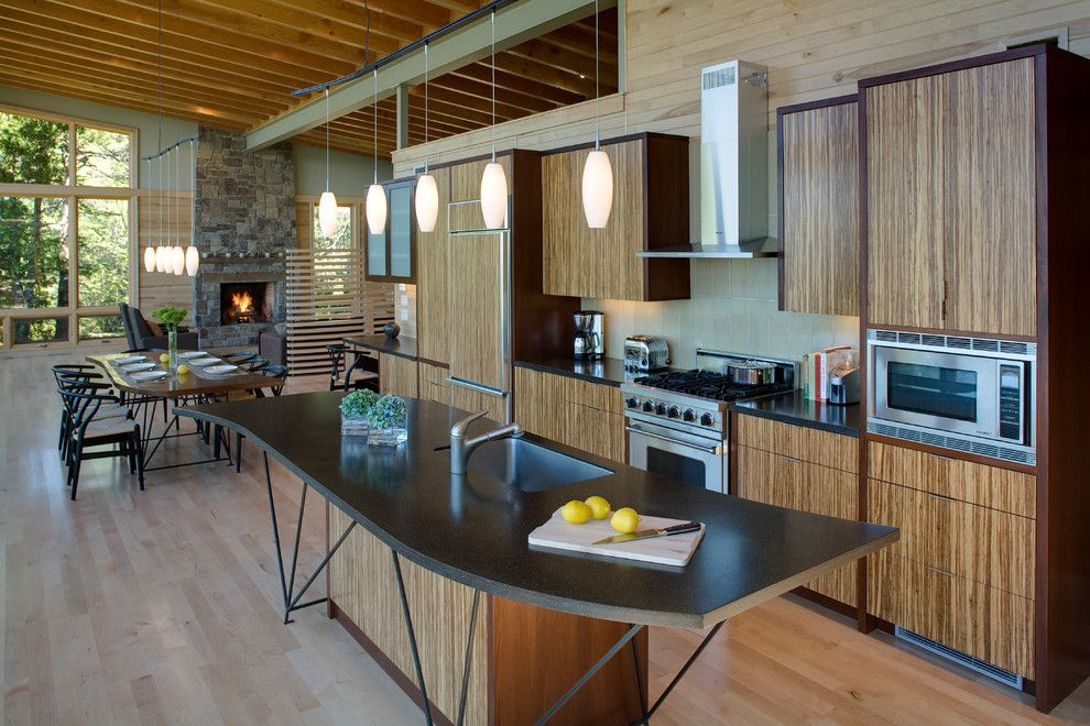 Shoreline Flooring for a Modern Kitchen with a Wood Floor and Eagle Harbor Cabin by Finne Architects