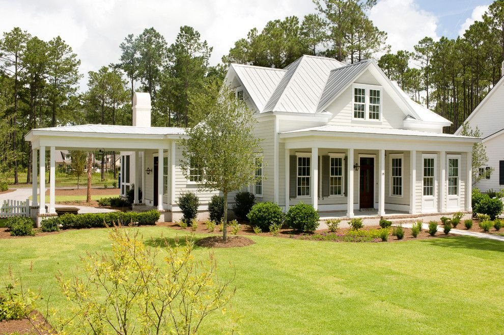 Shoreline Flooring for a Traditional Exterior with a Shutters and the Jekyll by Shoreline Construction and Development