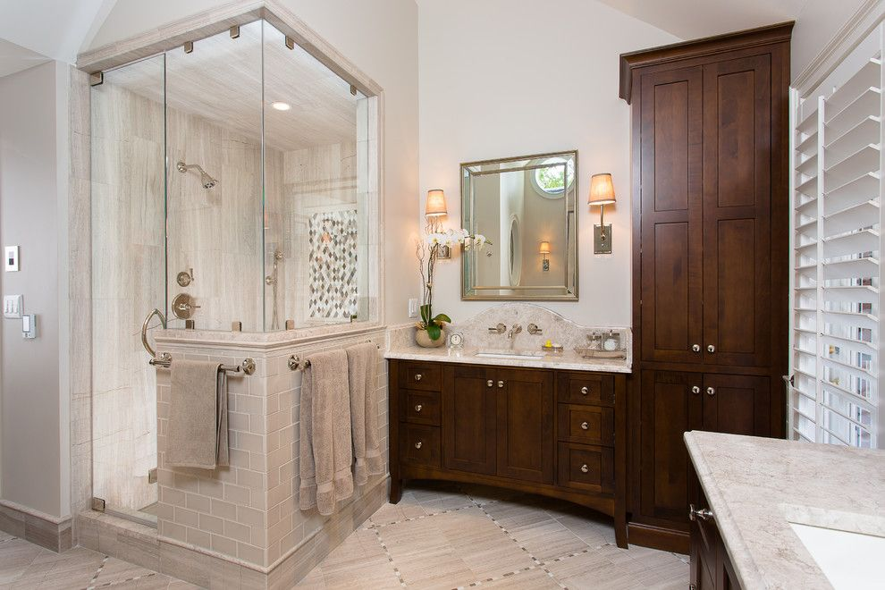 Shower Doors and Enclosures for a Traditional Bathroom with a Dark Wood Bathroom Vanity and Huntcliff Cliff Master Bath by Kitchen + Bath Artisans