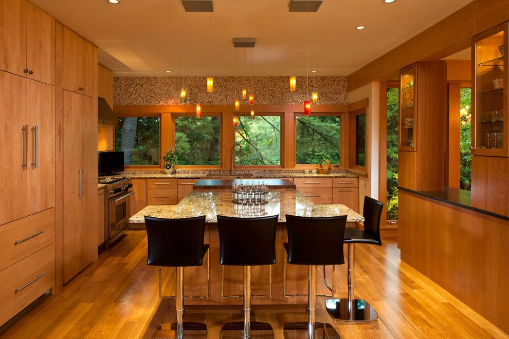 Sienna Bordeaux Granite for a Contemporary Kitchen with a Orange Pendant Light and Lake Luzerne House by Phinney Design Group