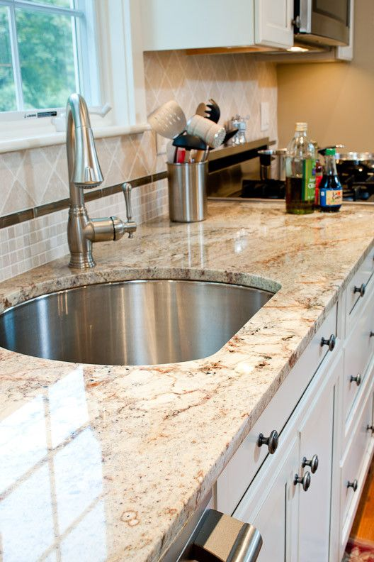 Sienna Bordeaux Granite for a Traditional Kitchen with a Cream Cabinets and Typhoon Bordeaux Granite Countertops by Counteredge
