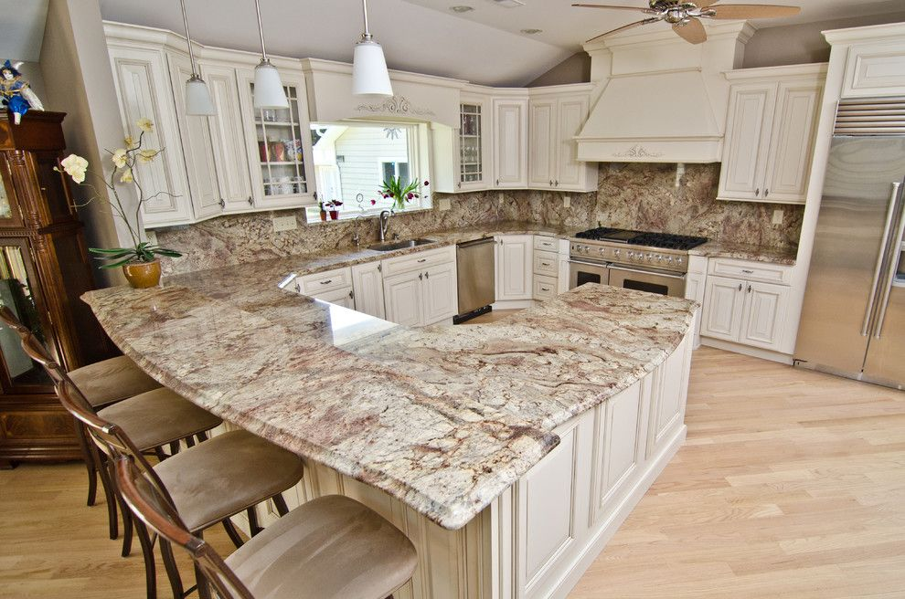 Sienna Bordeaux Granite for a Traditional Kitchen with a White Granite and Typhoon Bordeaux Granite with Full Backsplash by Granite Grannies
