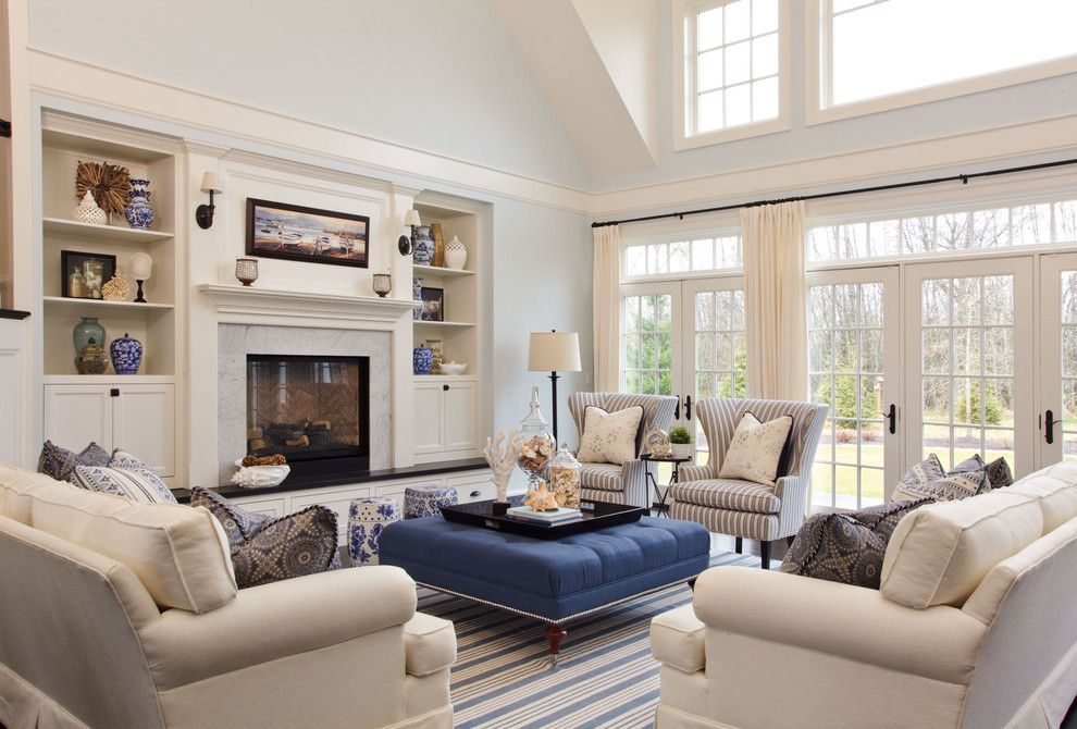 Sierra Pacific Windows for a Beach Style Living Room with a Striped Rug and Camelia Court by Garrison Hullinger Interior Design Inc.