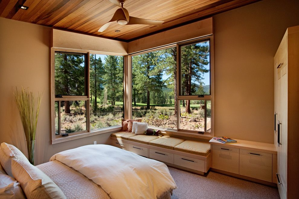Sierra Pacific Windows for a Rustic Bedroom with a Storage Bench and Bedroom 02 by Ryan Group Architects