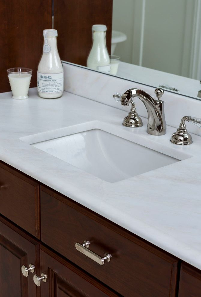 Sigma Faucets for a Traditional Bathroom with a Honed Marble and Elegant Family Home by Cadenza Granite and Marble