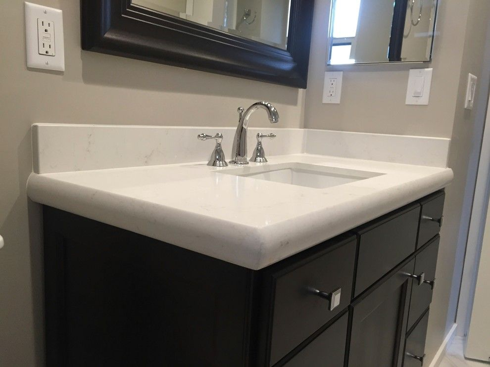 Sigma Faucets for a Transitional Bathroom with a Chrome Faucet and Simple Elegance by Kitchen & Bath Works