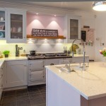 Silestone for a Farmhouse Kitchen with a Aga Over Mantel and Handpainted in Frame Shaker Kitchen with Aga by Planet Furniture