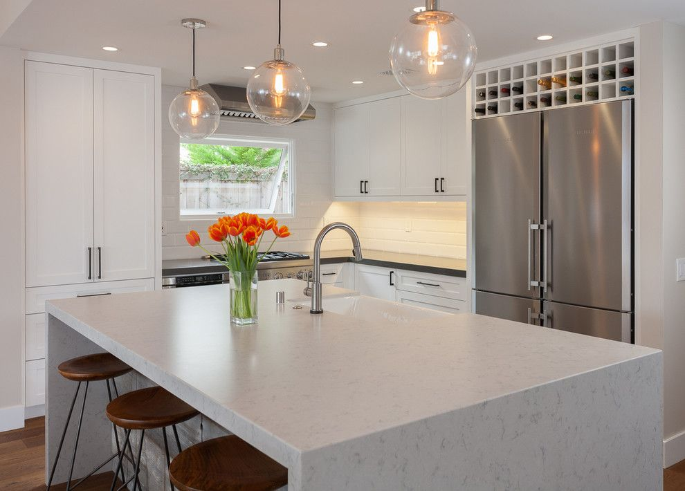 Silestone Lagoon for a Contemporary Kitchen with a Pendant Fixture and Balboa Coves Remodel by Eric Aust Architect