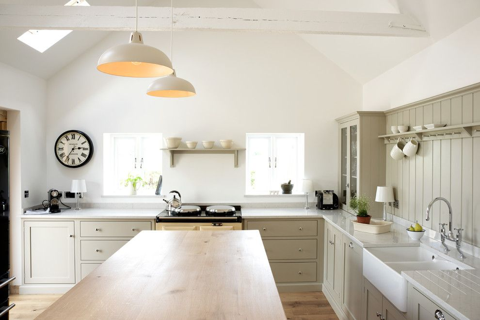 Silestone Lagoon for a Farmhouse Kitchen with a Kitchen Wall Clock and the Warwickshire Barn Shaker Kitchen by deVOL by deVOL Kitchens