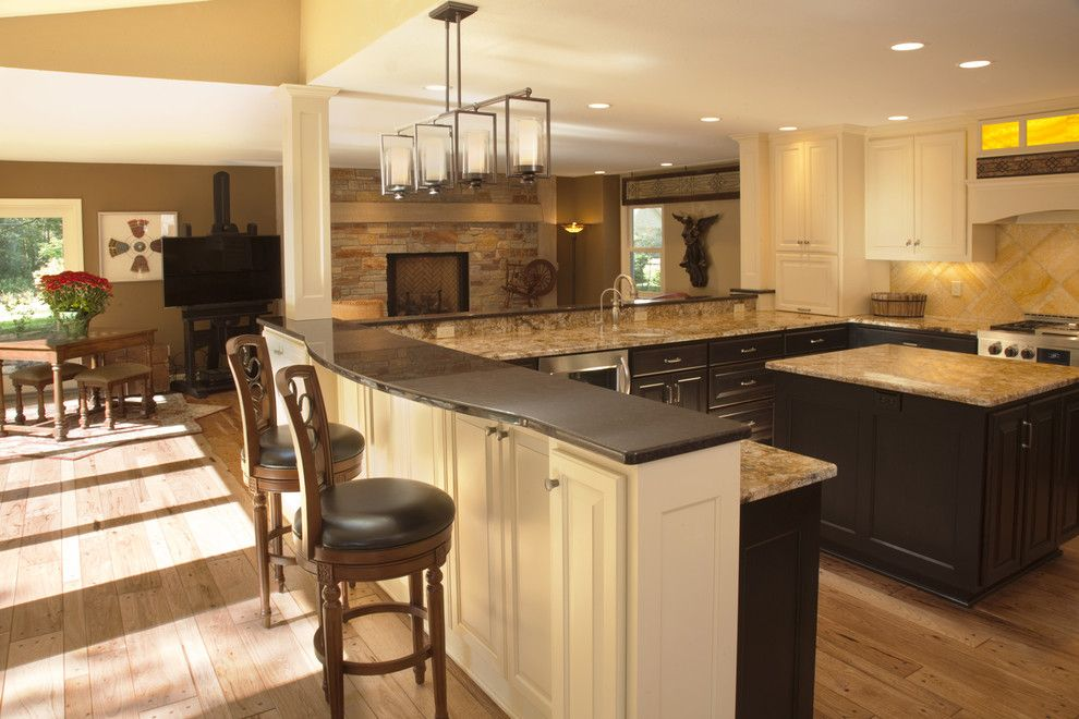 Silestone vs Granite for a Contemporary Kitchen with a Barstool and Breakfast Counter by Wade Design & Construction Inc