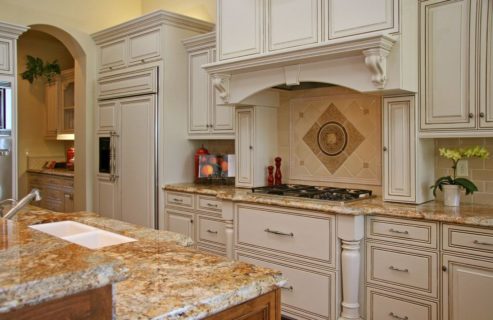 Silestone vs Granite for a Traditional Kitchen with a Cookbook Stand and Landmark Builders by Landmark Builders