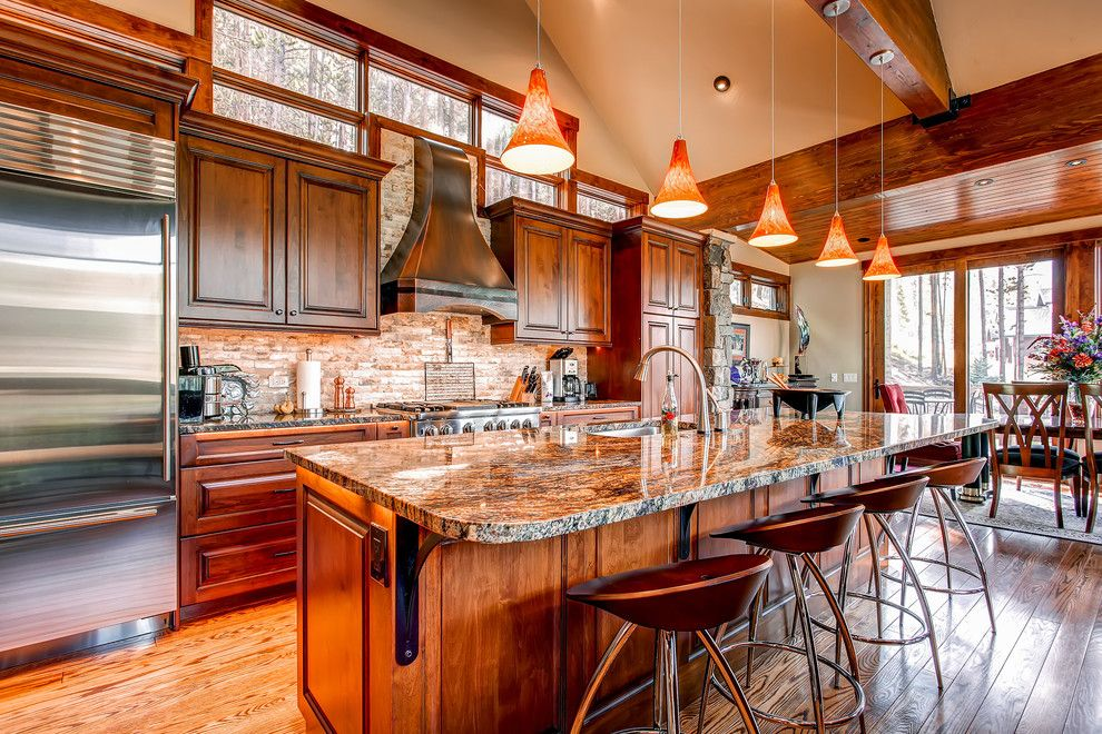 Silestone vs Granite for a Traditional Kitchen with a Sliding Glass Door and 5 Bonanza Trail by Pinnacle Mountain Homes