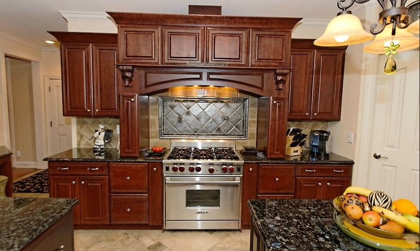 Silver Pearl Granite for a Traditional Kitchen with a Backsplash and Collection by Viscusi Builders Ltd.