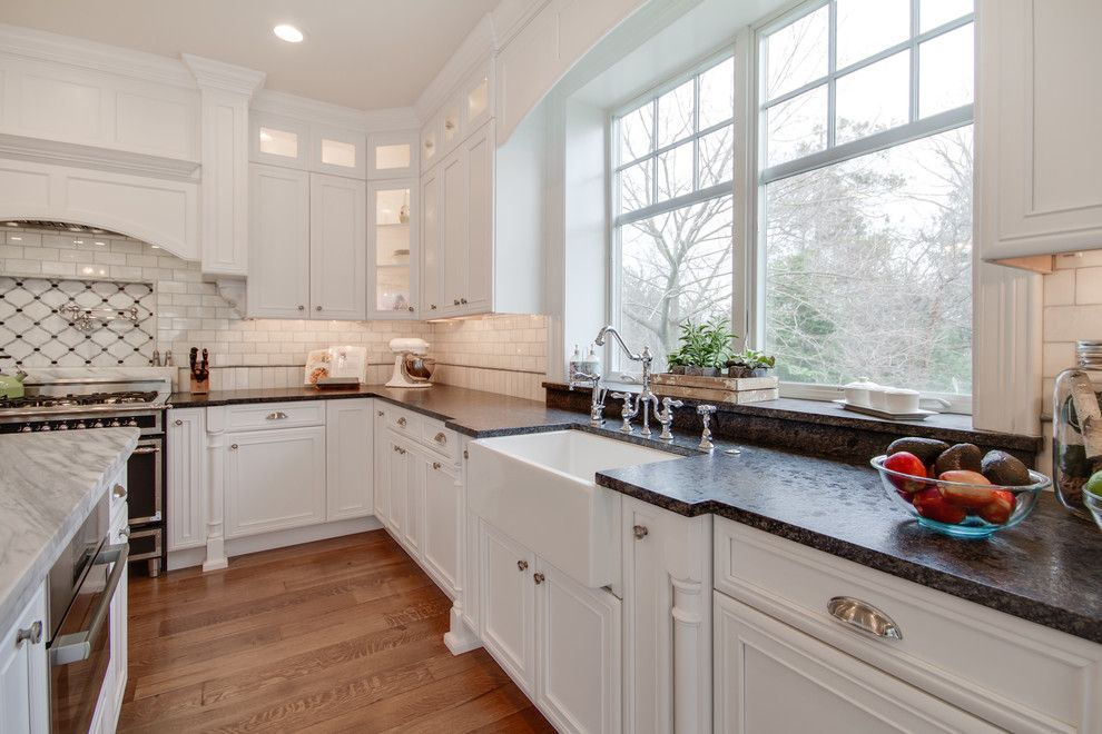 Silver Pearl Granite for a Traditional Kitchen with a Bridge Faucet and Mont Blanc Quartzite & Silver Pearl Granite in a White Kitchen by Stoneshop