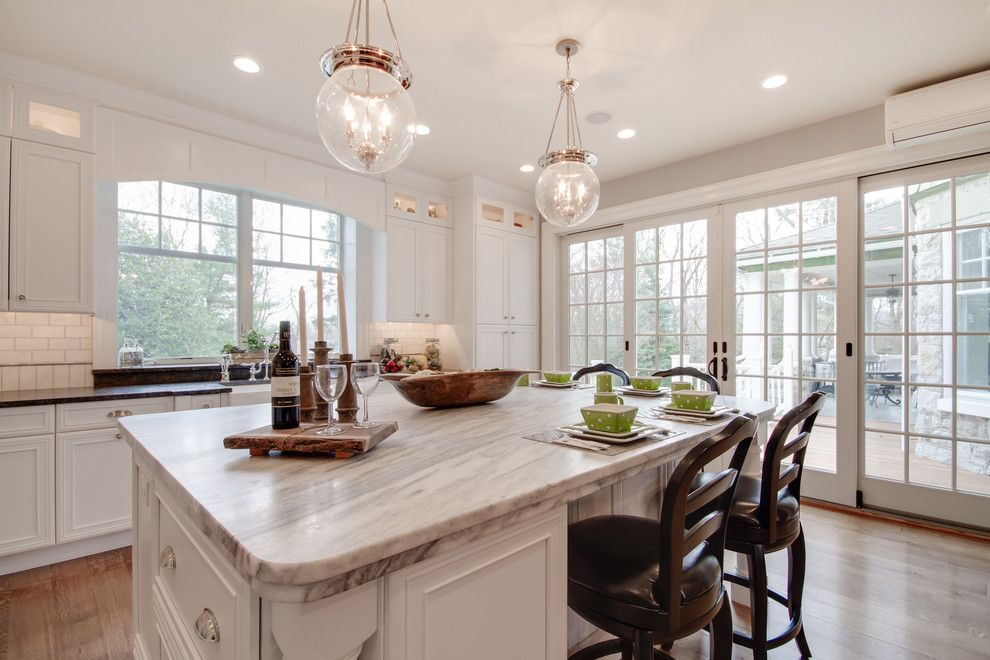 Silver Pearl Granite for a Traditional Kitchen with a White Cabinetry and Mont Blanc Quartzite & Silver Pearl Granite in a White Kitchen by Stoneshop