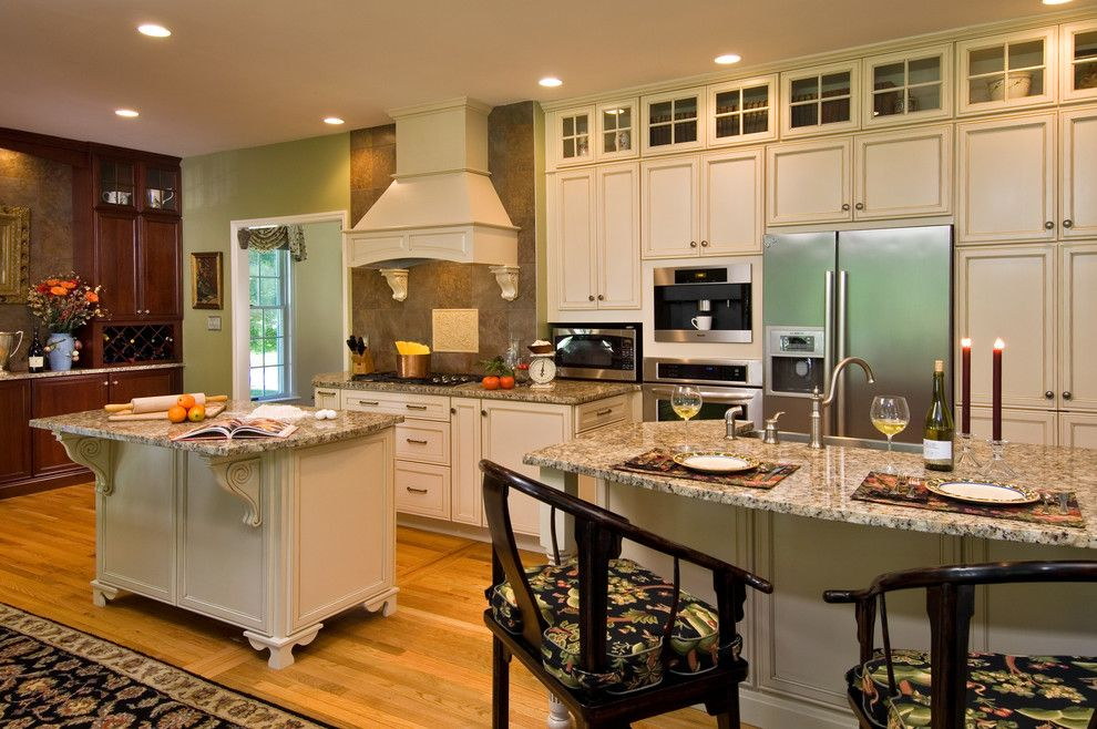 Silverado Building Materials for a Traditional Kitchen with a Two Islands Hardwood Floors and Spectacular Renovation by Kitchen and Bath World, Inc