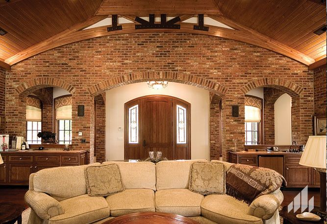 Silverado Building Materials for a Traditional Living Room with a Brick Product and Accent Wall Using the Color, English Pub Thin Brick. by Silverado Building Materials