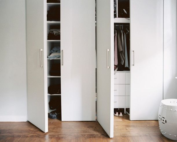Simons Hardware for a Modern Closet with a Built in Storage and Williamsburg Residence by Leonora Mahle, Llc