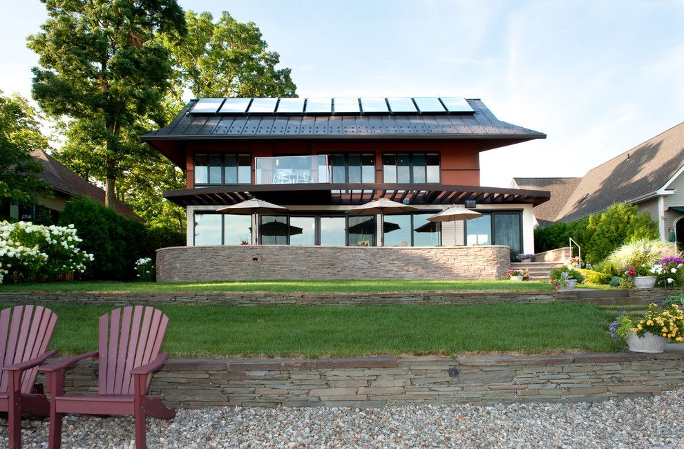 Simple Solar Homesteading for a Contemporary Exterior with a Stone Wall and Lake Front Home, Burlington, Vermont by Mary Prince Photography