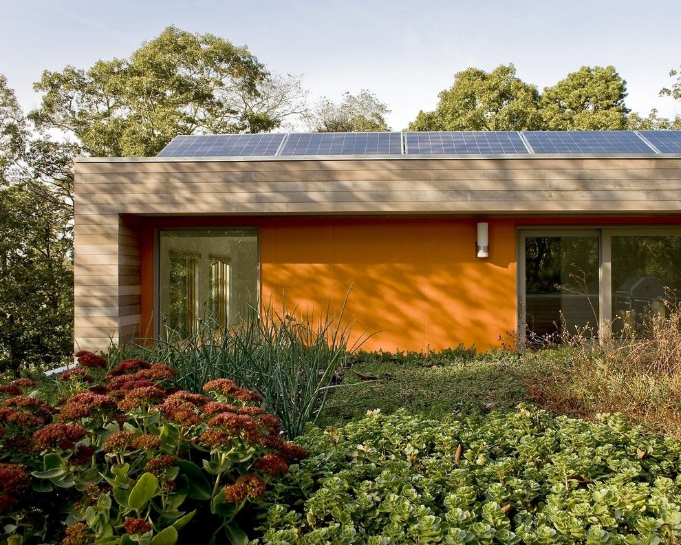 Simple Solar Homesteading for a Modern Exterior with a Solar and Living Green Roof with Solar Panels by Zeroenergy Design