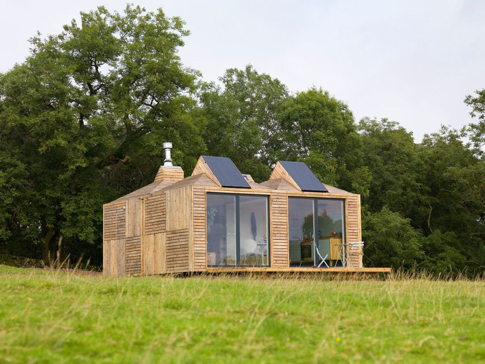 Simple Solar Homesteading for a Rustic Exterior with a Eco and Solar Panels Integrated Into the Bothy's Roof Design. by Echo Living