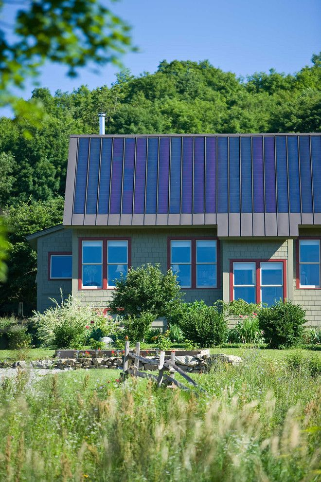 Simple Solar Homesteading for a Rustic Exterior with a Lawn and Environmentally Friendly by Truexcullins Architecture + Interior Design