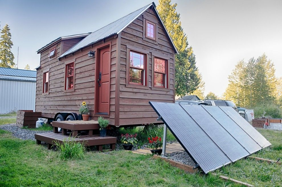 Simple Solar Homesteading for a Rustic Exterior with a Potted Plants and Our Tiny Tack House by the Tiny Tack House