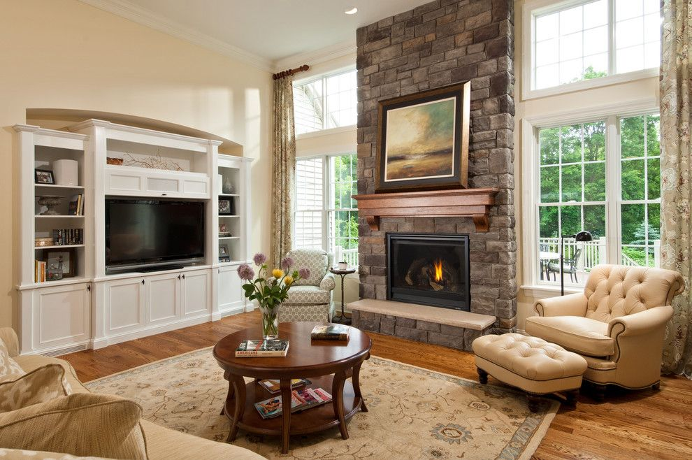 Simplex Homes for a Traditional Living Room with a Great Room and 2012 Parade of Homes by Belmonte Builders