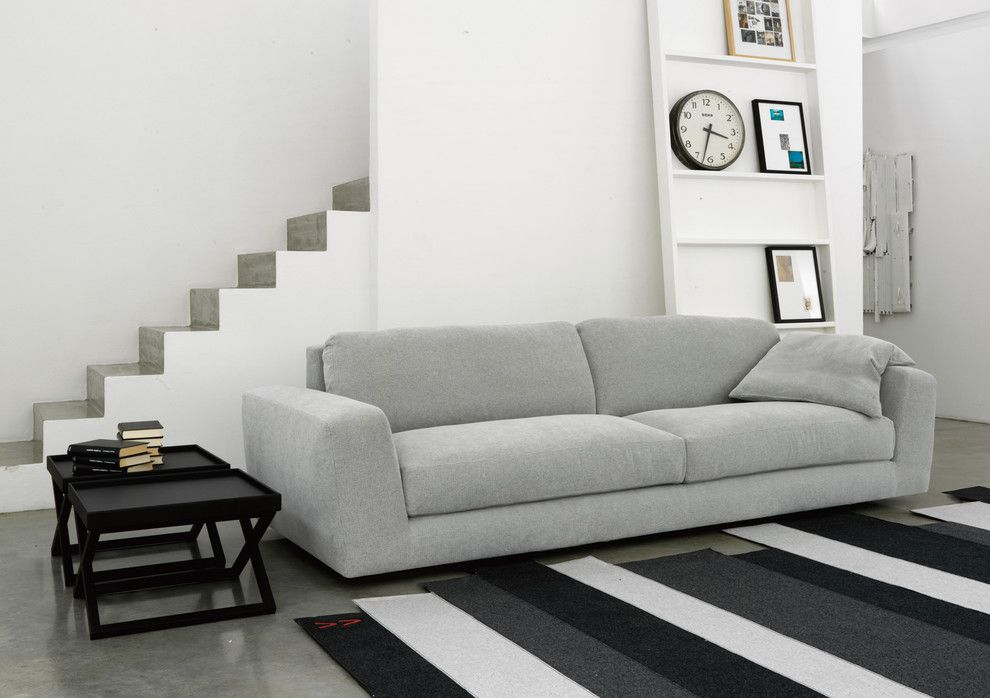 Simplicity Sofas for a Modern Family Room with a Wall Clock and Modular Sofa 05226 by Usona
