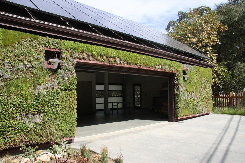 Singing River Electric for a Contemporary Garage with a Moss Exterior and Baer Retreat by Osborne Architects