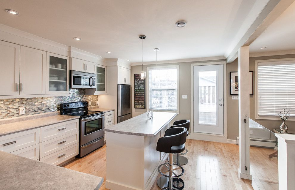 Singing River Electric for a Contemporary Kitchen with a Wood Floor and My Houzz: Open Concept Apartment Above Retail in Downtown St. John's by Becki Peckham