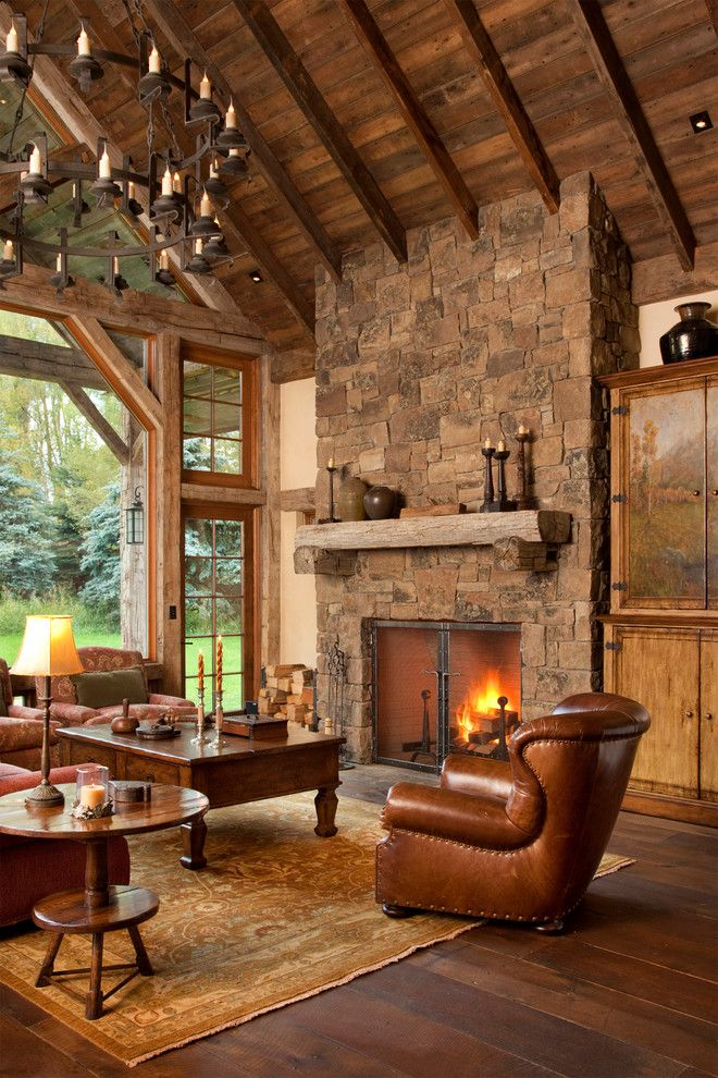 Singing River Electric for a Rustic Living Room with a Dark Stianed Wood and Snake River Guest House by Jlf & Associates, Inc.
