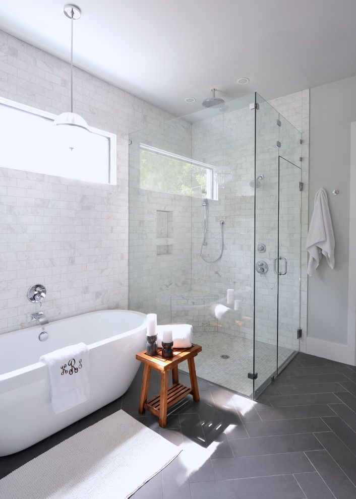 Sitterle Homes for a Transitional Bathroom with a Gray Floor Tile and Forest Hills Modern Farmhouse by Lilli Design