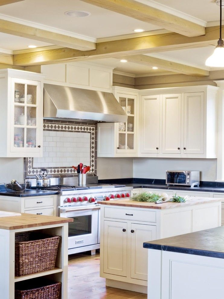 Soap Stone for a Farmhouse Kitchen with a Range Hood and Farmhouse Revival by Cushman Design Group