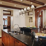 Soapstone for a Rustic Kitchen with a Stainless Steel Sink and Landrum Sc Residence by the Belding Group, Inc