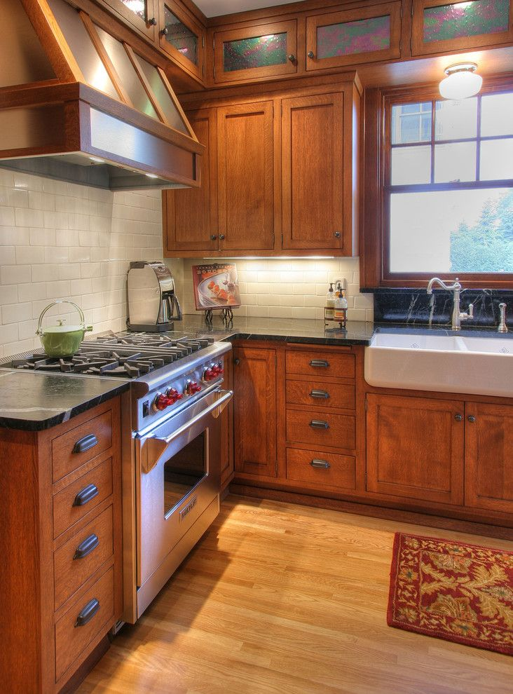 Soapstone vs Granite for a Craftsman Kitchen with a Wainscot and Craftsman Kitchen by W.b. Builders