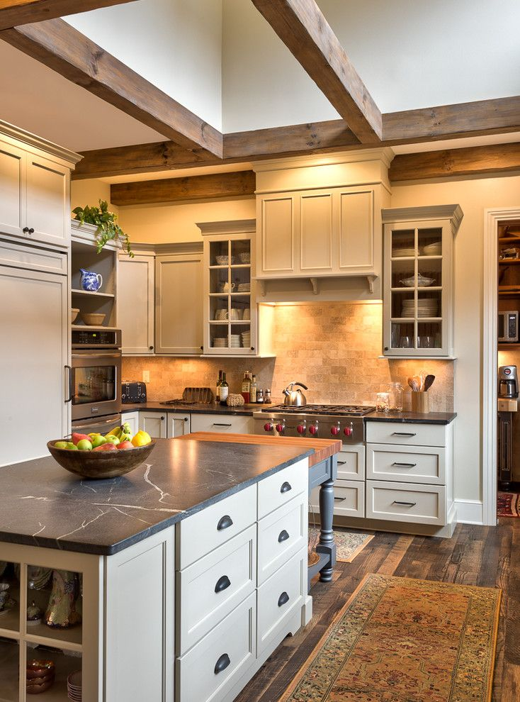 Soapstone vs Granite for a Farmhouse Kitchen with a Gray Countertop and Pennsylvania Farmhouse Inspired Kitchen by Benbow & Associates