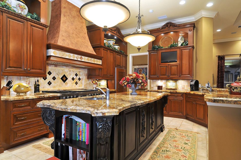 Soapstone vs Granite for a Mediterranean Kitchen with a Tile Backsplash and Grand Kitchen by Bella Luna Services, Inc.
