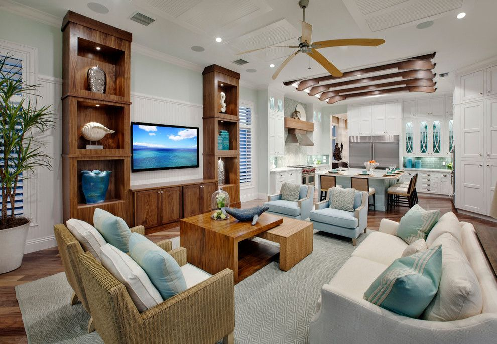 Sobe Furniture for a Tropical Family Room with a White Kitchen and