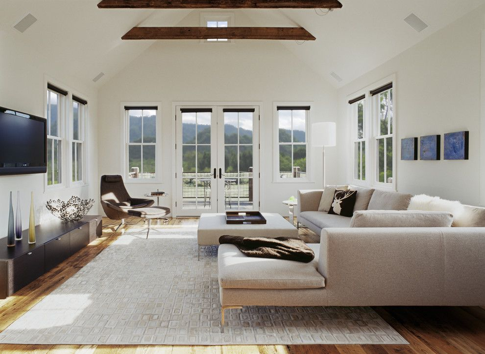 Sofa Mart Denver for a Transitional Living Room with a Exposed Beams and Mountain House by Tim Cuppett Architects