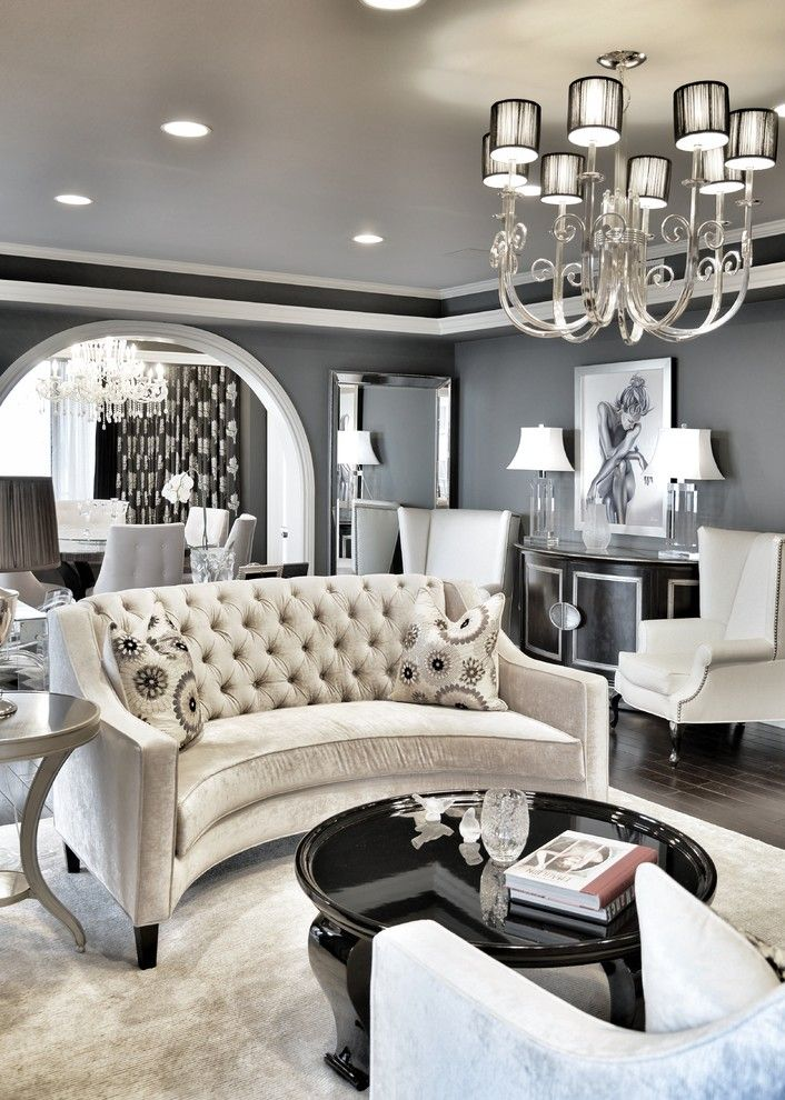 Sofa Mart for a Transitional Living Room with a Black Lacquer Coffee Table and Neman Residence by Steven Cordrey Interior Design