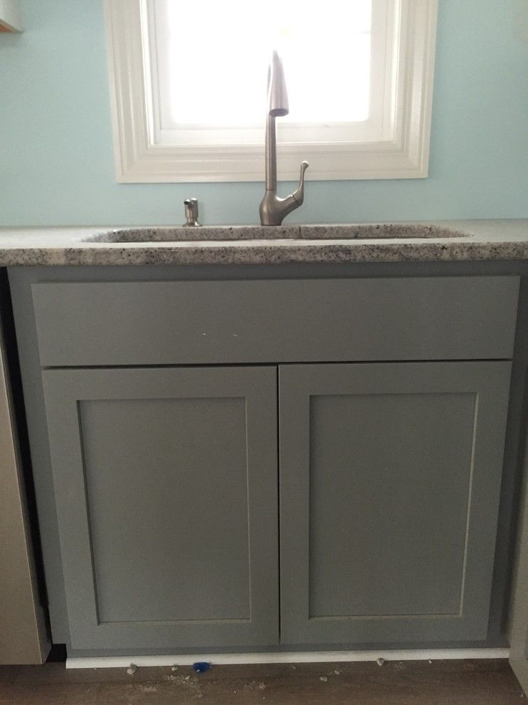 Solera Sinks for a Beach Style Kitchen with a Beach Home and Marblehead Vacation Home by Britany Grieger with Modern Builders Supply