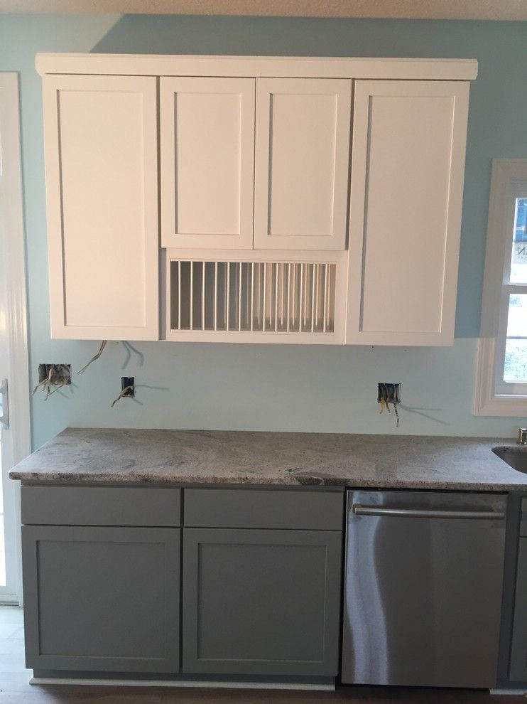 Solera Sinks for a Beach Style Kitchen with a Tinted Varnish and Marblehead Vacation Home by Britany Grieger with Modern Builders Supply