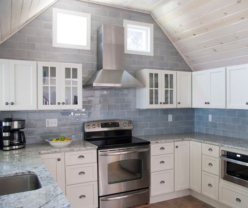 Sonoma Tile for a Beach Style Kitchen with a Whitewashed Ceiling and Beach House Renovation by Judy Cook Interiors, Llc