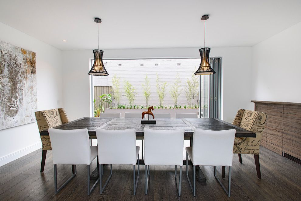 South Dade Lighting for a Contemporary Dining Room with a Carver Chairs and SOUTH COOGEE - House by Capital Building