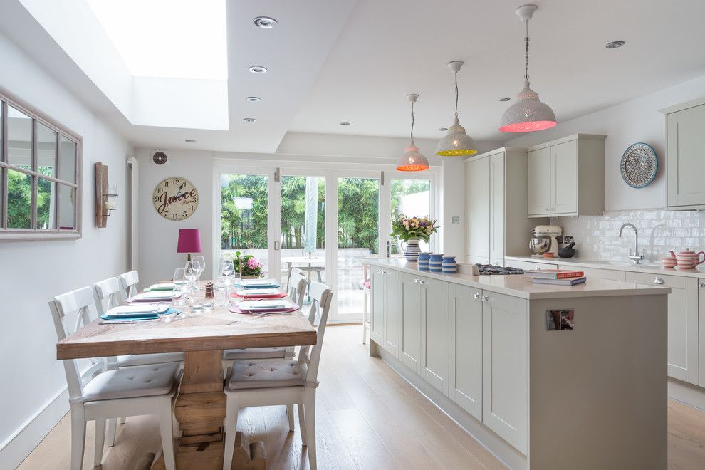 South Dade Lighting for a Transitional Kitchen with a Colourful Kitchen and London Town House by Town House Interiors